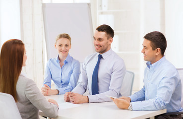business team interviewing applicant in office