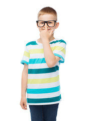 smiling little boy in eyeglasses