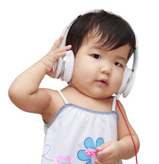 Cute kid listening to music on headphones and enjoying 003