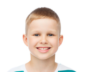 smiling little boy over white background