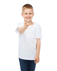 little boy in blank white t-shirt pointing at you
