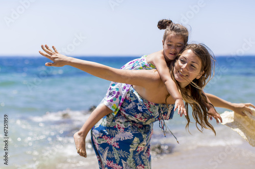 canvas print picture Mother and daughter on the beach