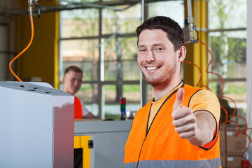 Machine operator showing thumbs up sign
