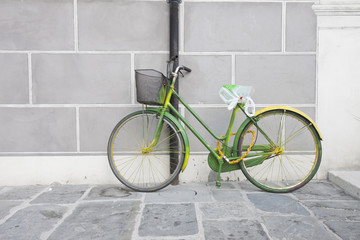 Green bike against the wall
