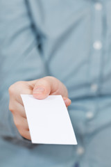 front view of blank business card in female hand