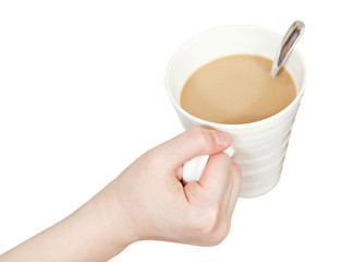 white cup with milk coffee in hand isolated