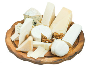 wooden plate with various cheeses