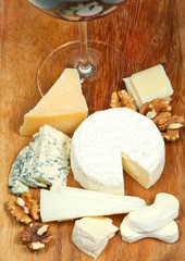 glass of red wine and assorted cheeses
