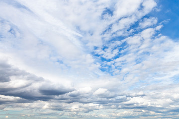 low cumuli clouds in blue sky