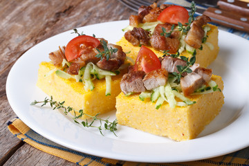 Slices of tasty polenta with meat and vegetables