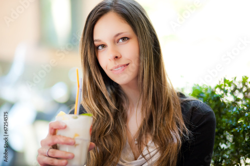 Beautiful woman having a drink