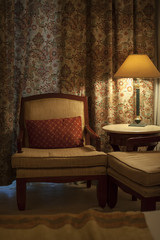 beautiful armchair and lamp in a hotel room