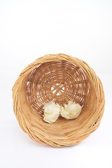 Trash rattan basket on isolated white