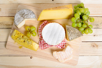 assortment of french cheeses and seasonal fruit