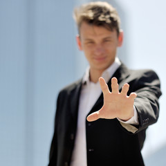 hand close-up of a young businessman - positive thinking concept