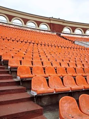 seating rows on a stadium with weathered chairs