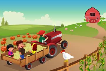 Kids on a hayride in a farm during Fall season