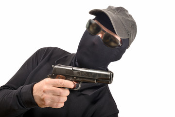 hooded man with a gun