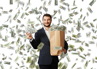 businessman standing with money