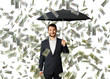 man with umbrella standing under money rain