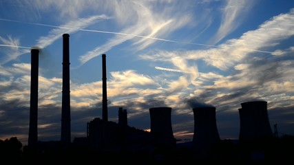 silhouette of power station at dusk, real time