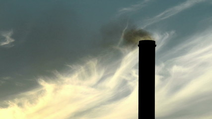 detail of smokestack  of power plant at dusk