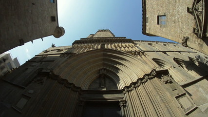Barcelona Gothic district looking up at medieval buildings.