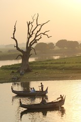 Sunset on the boat, view from U Bein Bridge