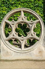 Rose window made of stone at Place de Vosge