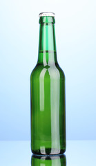 bottle of beer on blue background