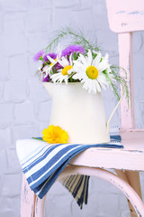 Bouquet of colorful flowers in decorative jug,