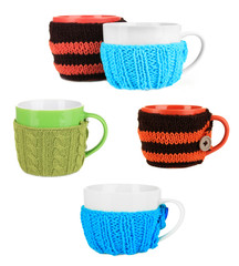 Cups with knitted thing on it isolated on white