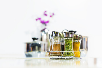 Powder spices in glass bottle jar