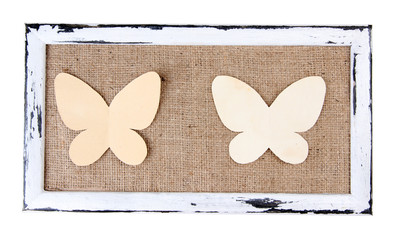 Wooden frame with paper butterflies isolated on white