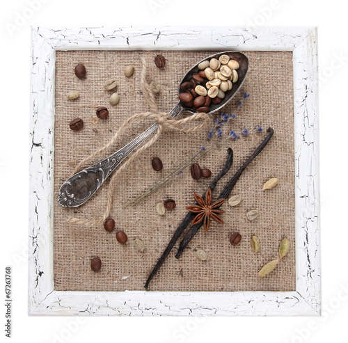 Wooden frame, vintage spoon and spices isolated on white