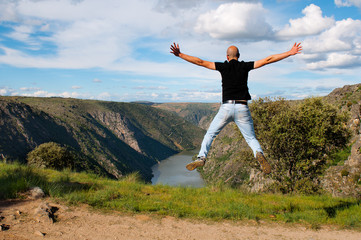 Young man jumping. Arribes del Duero river natural park