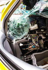Inside of the yellow car accident which demolished broken glass