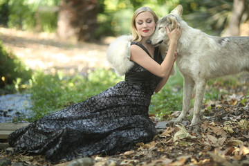 Lovely Woman Posing With a Wolf