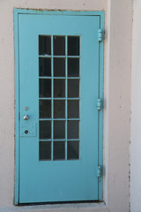 rustic blue door with silver doorknob