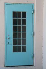 rustic blue door with silver doorknob