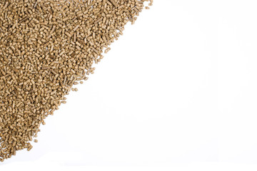 sloping frame with pellets of grain on white background