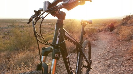 Mountain bike on desert trail at sunset