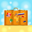 Suitcase with world map and flags