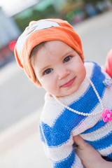 child in an orange cap