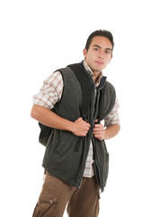handsome latin man wearing backpack and vest