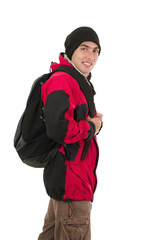 young man posing wearing red coat and backpack