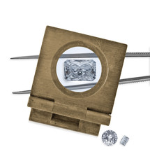 vintage loupe over diamond and tweezers