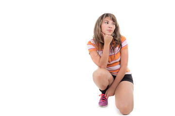hispanic girl kneeling with hand on her chin
