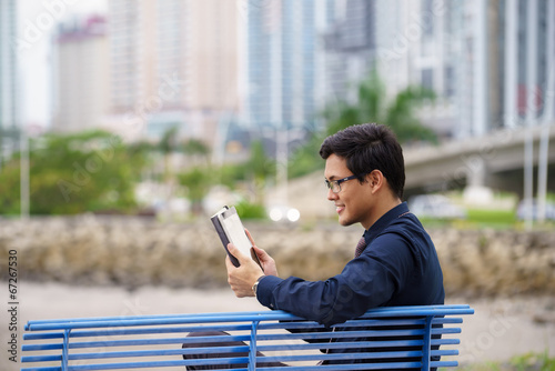 Portrait of asian office worker on bench