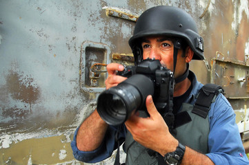 Photojournalist documenting war and conflict
